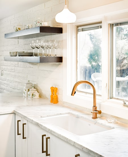 gold tap in kitchen
