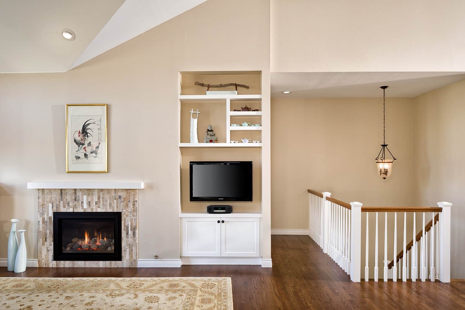 Melton Design Build - Louisville Remodel - Living Room Fireplace and Banister