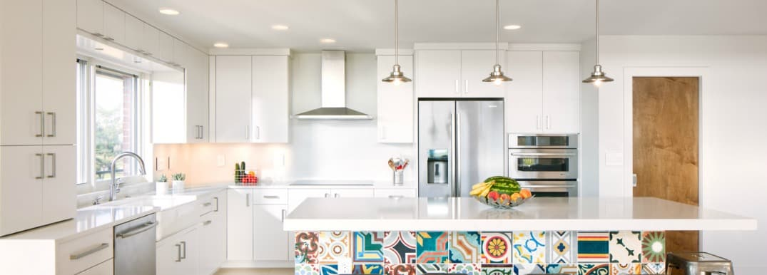 photo of white kitchen with colorful tile