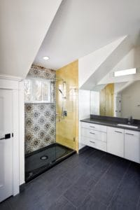 yellow accent tile shower
